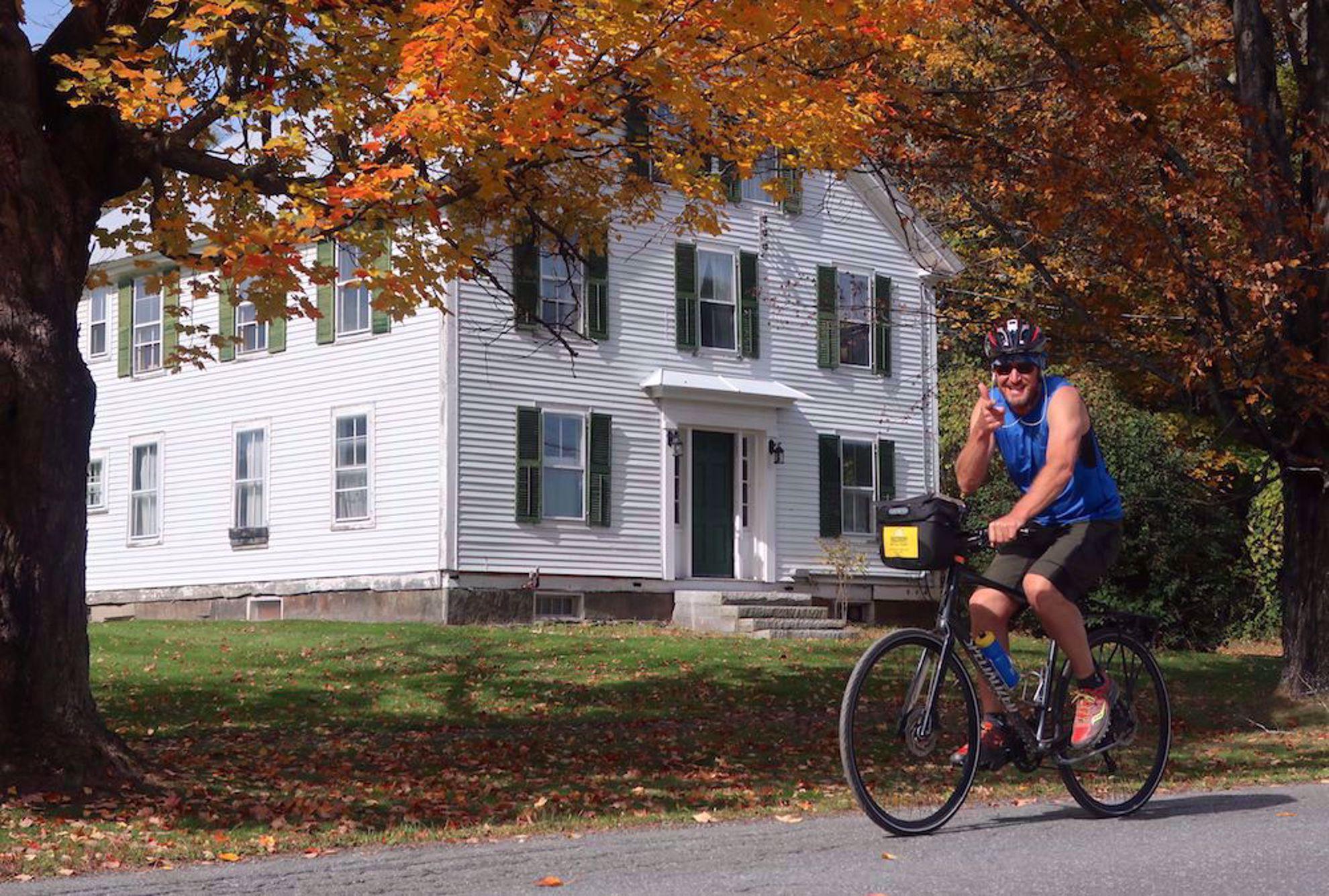 Biker near house Upper Valley