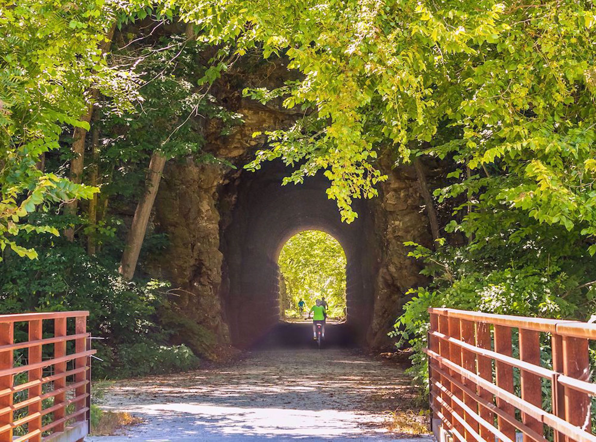 Tunnel and biker on Katy Trail