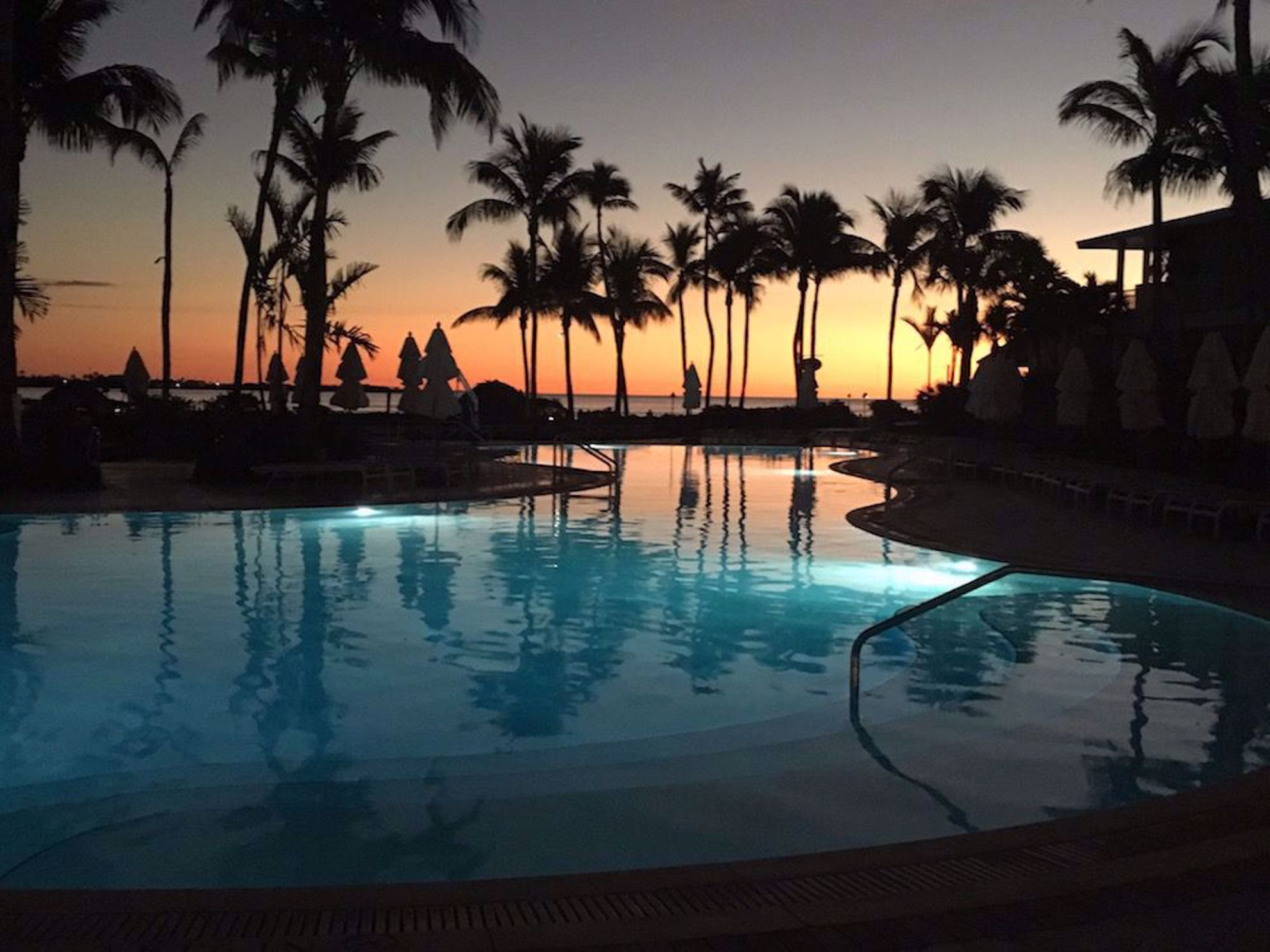 Sunset over pool at Hawks Cay
