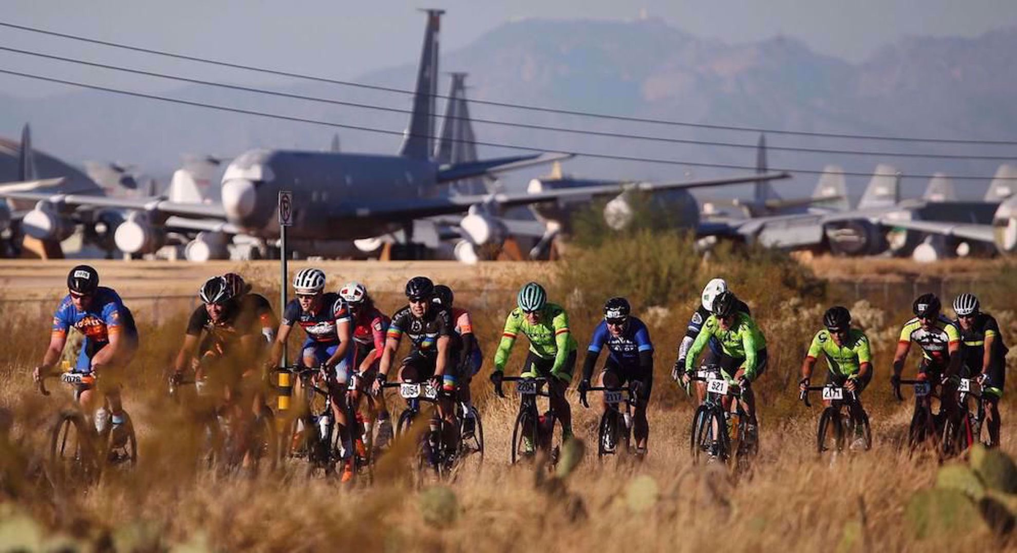 El tour participants pass the Boneyard airplanes